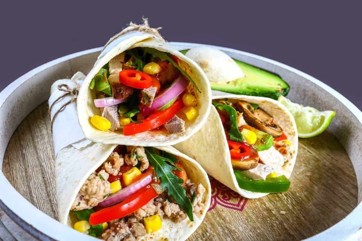 Tortilla wraps (lettuce, tomatoes, avocadoes, beans, and meat)