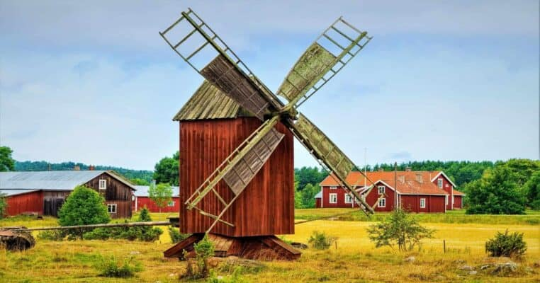 Windmill in a old vintage rural landscape. From the island Åland, Finland