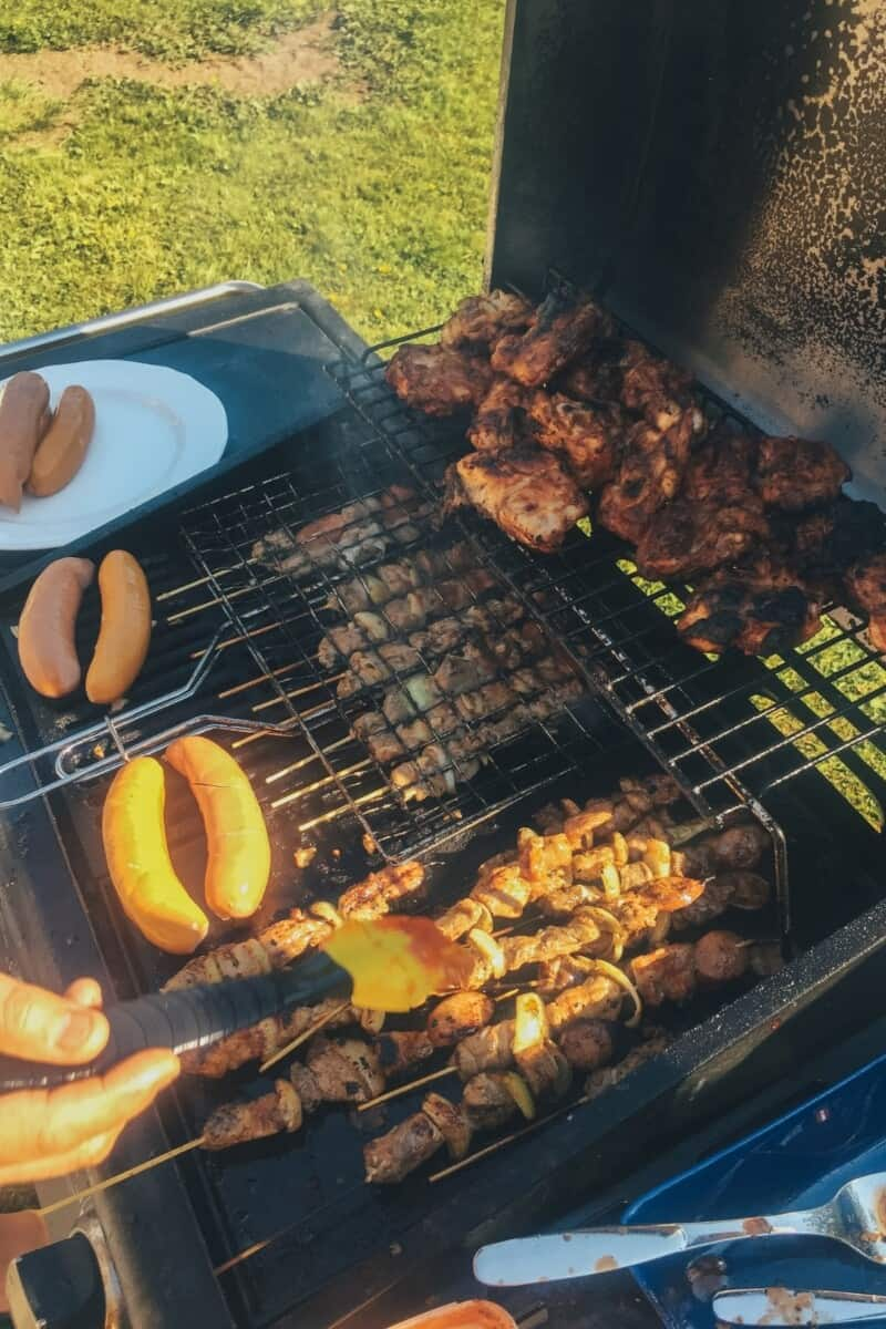Grilling sausages during Juhannus.
