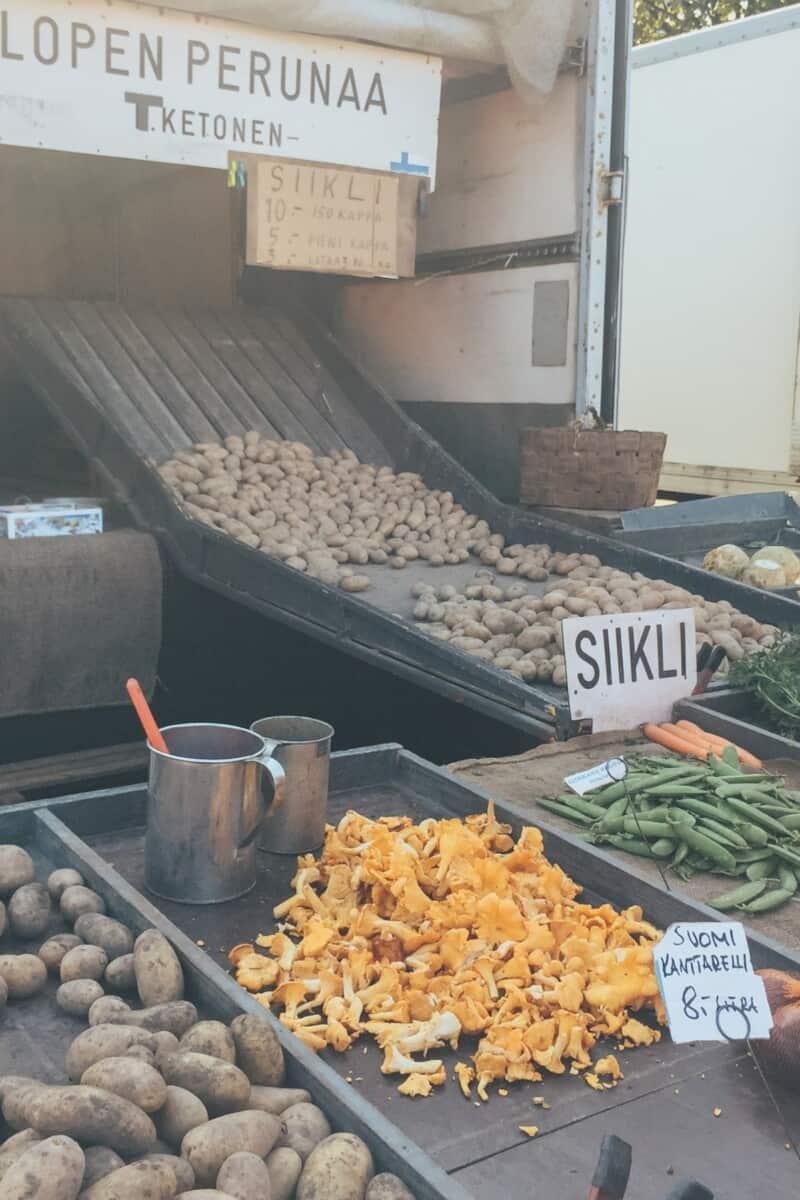 Finnish market stall selling fresh mushrooms and Finnish new potatoes.